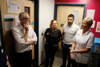 In this file photo taken on Oct. 30, 2019 Britain's Labour Party leader Jeremy Corbyn listens to staff as he visits Crawley Hospital in Crawley, south of London.  Britain's snap election next week was called to resolve the impasse over Brexit but much of the campaign has instead been dominated by explosive rows over healthcare. — AFP