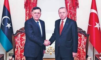 Recep Tayyip Erdogan, right, greets Fayez Al-Sarraj in Istanbul in this Nov. 28, 2019 file photo. — AFP