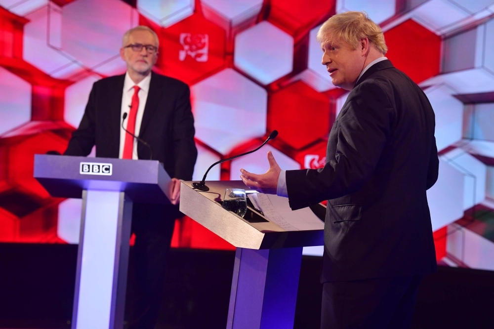 Britain's Prime Minister Boris Johnson (R) and Britain's main opposition Labour Party leader Jeremy Corbyn participate in the BBC Prime Ministerial leaders debate, at the studio in Maidstone, Kent on Friday. -AFP