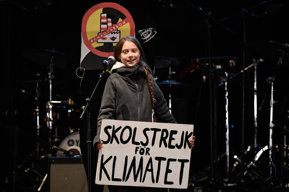 Swedish climate activist Greta Thunberg delivers a speech after a mass climate march to demand urgent action on the climate crisis from world leaders attending the COP25 summit, in Madrid, on Friday. -AFP