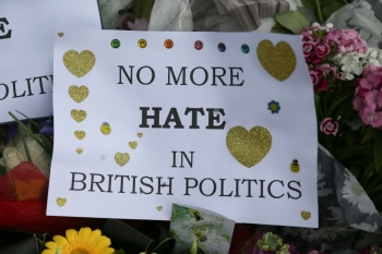 In this file photo taken on June 18, 2016 Flowers and tributes are piled in remembrance of slain Labour MP Jo Cox including a board carrying messages in Parliament Square in front of the Houses of Parliament in central London. -AFP