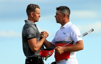 Henrik Stenson of Sweden shakes hands with Gary Woodland of the United States after winning the Hero World Challenge at Albany in Nassau, Bahamas, on Saturday. — AFP