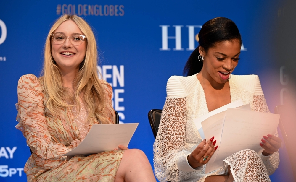 Actress Dakota Fanning, left, and Susan Kelechi Watson attend the 77th Annual Golden Globe Awards nominations announcement at the Beverly Hilton hotel in Beverly Hills on Monday. — AFP