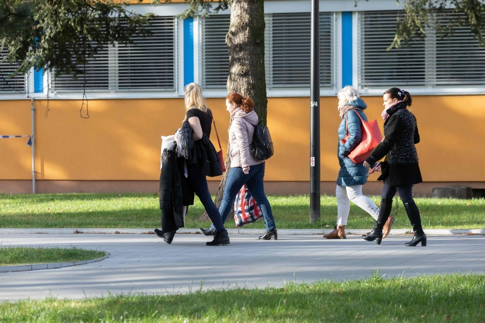 Employees leave the Faculty Hospital in Ostrava, eastern Czech Republic, after a gunman opened fire killing six people, on Tuesday. — AFP