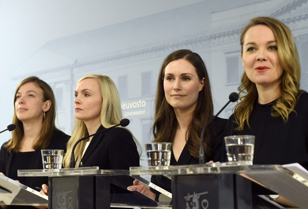 Minister of Education Li Andersson, left, Minister of Interior Maria Ohisalo, second left, Prime Minister Sanna Marin, second right, Minister of Finance Katri Kulmuni, right, give a press conference of the new Finnish government in Helsinki, Finland, on Tuesday. — AFP