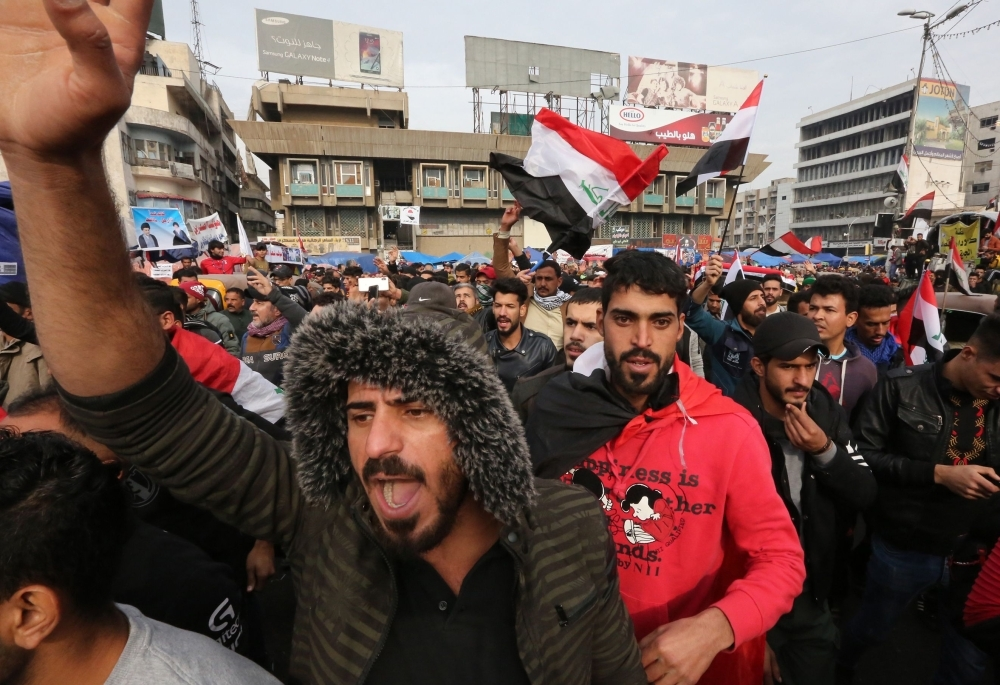 An Iraqi demonstrator wears a Guy Fawkes mask at Tahrir square in the capital Baghdad amid ongoing anti-government protests on Tuesday. — AFP
