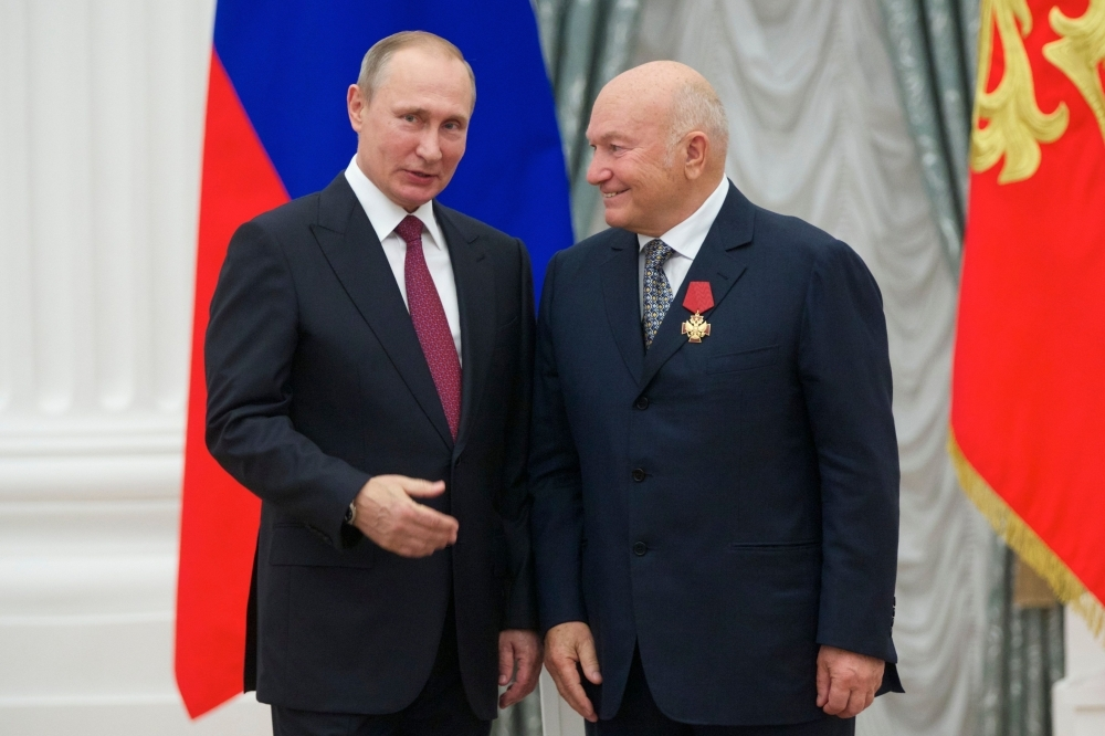 Russian President Vladimir Putin, left, stands after presenting a medal to former Moscow Mayor Yuri Luzhkov during an awarding ceremony at the Kremlin in Moscow in this Sept. 22, 2016 file photo. — AFP