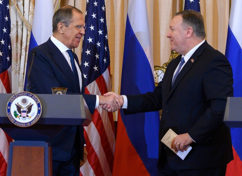 US Secretary of State Mike Pompeo, right, shakes hands with Russian Foreign Minister Sergey Lavrov during a press conference at the US State Department in Washington on Tuesday. — AFP