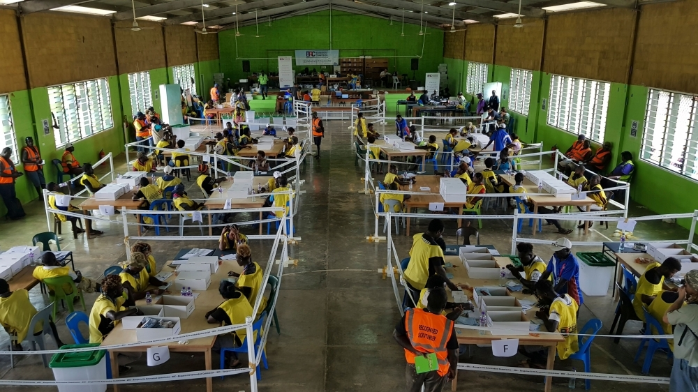 Bougainville Referendum Commission staff count votes prior to the historic referendum announcement in Bougainville on Tuesday. — AFP