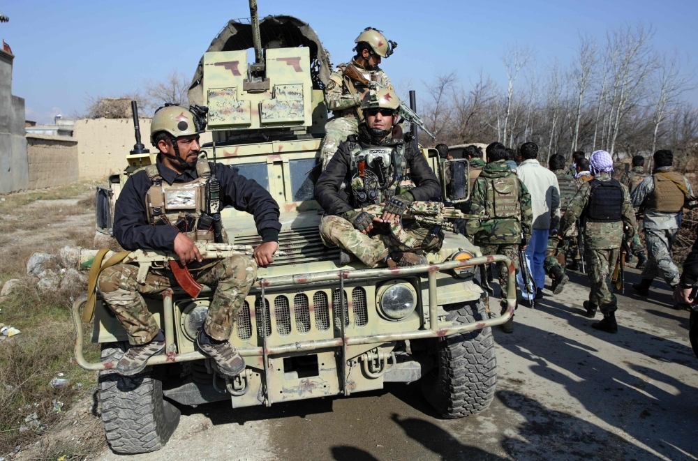 Afghan security forces arrive at the site of a car bombing near the largest US military in Afghanistan, north of Kabul in Parwan province, on Wednesday. — AFP