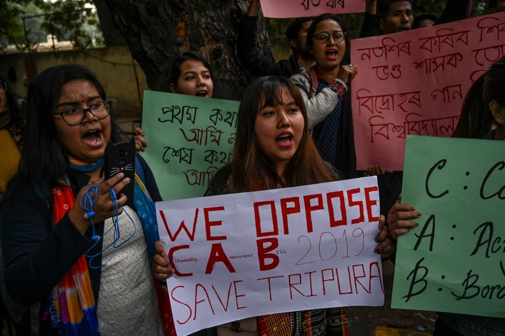 Protesters from northeast India residing in the capital city shout slogans against the government's Citizenship Amendment Bill 2019 (CAB) during a protest in New Delhi on Wednesday. — AFP