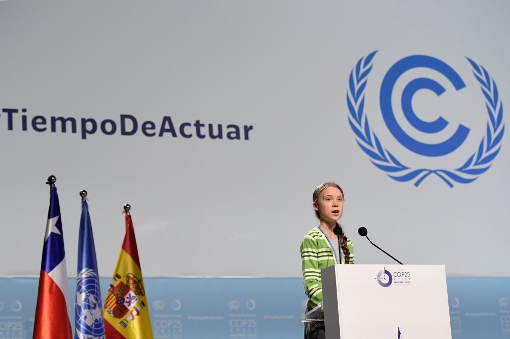Swedish climate activist Greta Thunberg gives a speech during a high-level event on climate emergency hosted by the Chilean presidency during the UN Climate Change Conference COP25 at the 'IFEMA - Feria de Madrid' exhibition centre, in Madrid, on Wednesday. — AFP