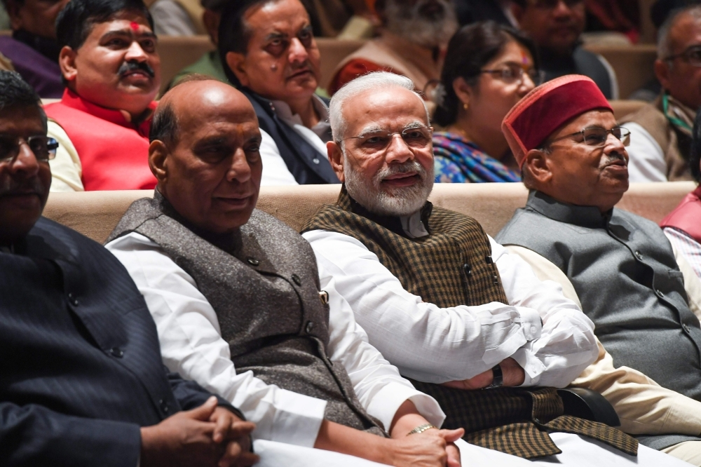 India's Prime Minister Narendra Modi, second right, and Defense Minister Rajnath Singh, second left, attend a Bharatiya Janata Party (BJP) parliamentary committee meeting at the Parliament House in New Delhi on Wednesday. — AFP