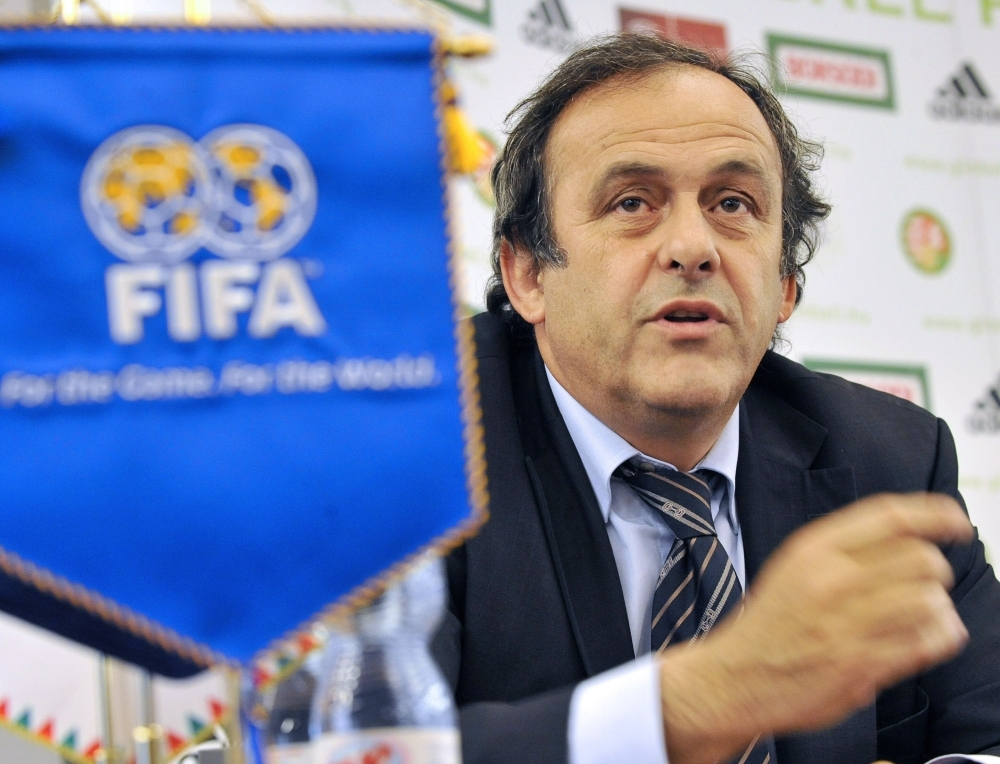 This file photo taken on May 2, 2009 shows former UEFA president Michel Platini looking on during an inauguration ceremony of the 'Technical and Training Center of the Hungarian Football Federation' in Telki, some 30 km northwest from Hungarian capital. FIFA is to take legal action by the end of the year to force Michel Platini to return 2 million Swiss francs ($2 million) he received