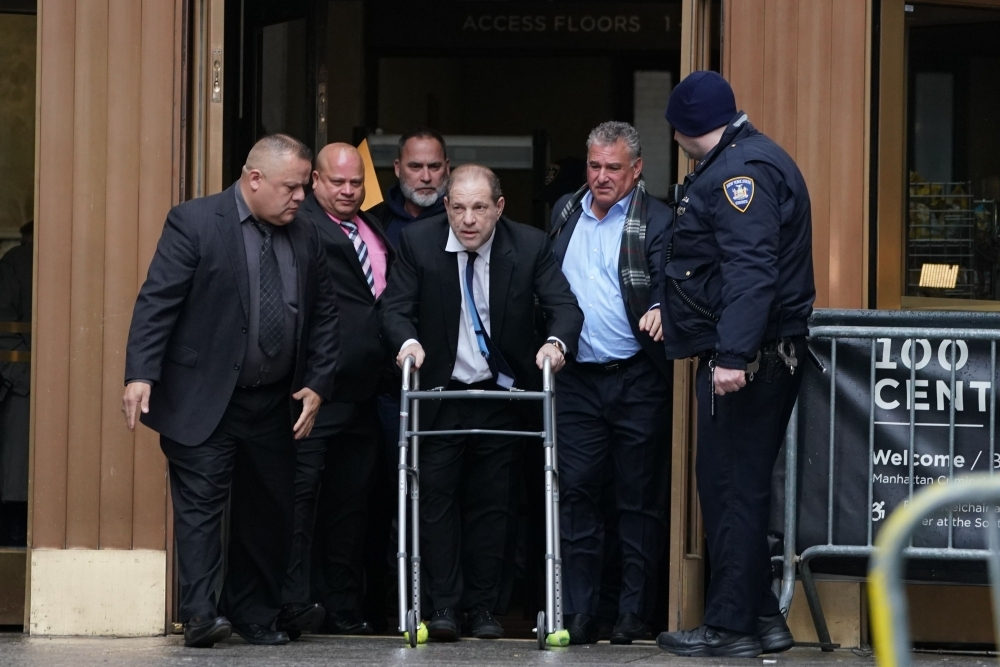 Harvey Weinstein leaves Manhattan Criminal Court, using a walker, following a hearing in New York on Wednesday. — AFP