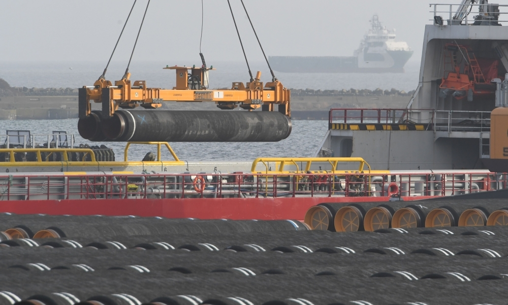 Tubes for the construction of the Nord Stream 2 pipeline are being loaded on a ship at the Mukran port in Sassnitz on the Baltic Sea island of Ruegen, northeastern Germany, on Thursday. — AFP