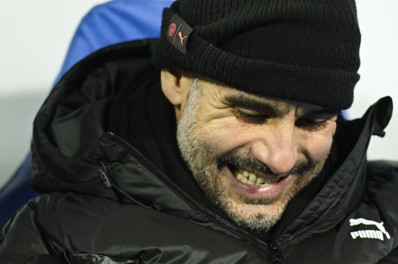 Manchester City's Spanish manager Pep Guardiola reacts during the UEFA Champions League Group C football match between GNK Dinamo Zagreb and Manchester City FC at the Maksimir Stadium in Zagreb on Dec. 11, 2019. — AFP