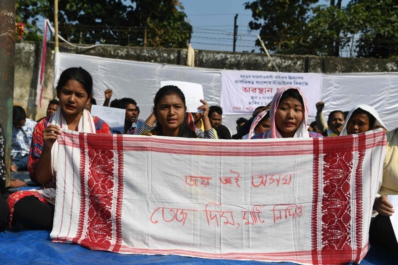 Protestors take part in a demonstration against the Indian government's Citizen Amendement Bill (CAB) in Guwahati on Saturday. -AFP