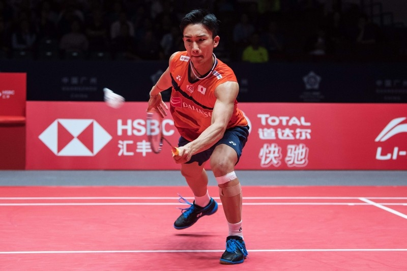 Kento Momota of Japan hits a return against Wang Tzu Wei of Taiwan during their men's singles semifinal match at the BWF World Tour Finals badminton tournament in Guangzhou in China's southern Guangdong province on Saturday. — AFP