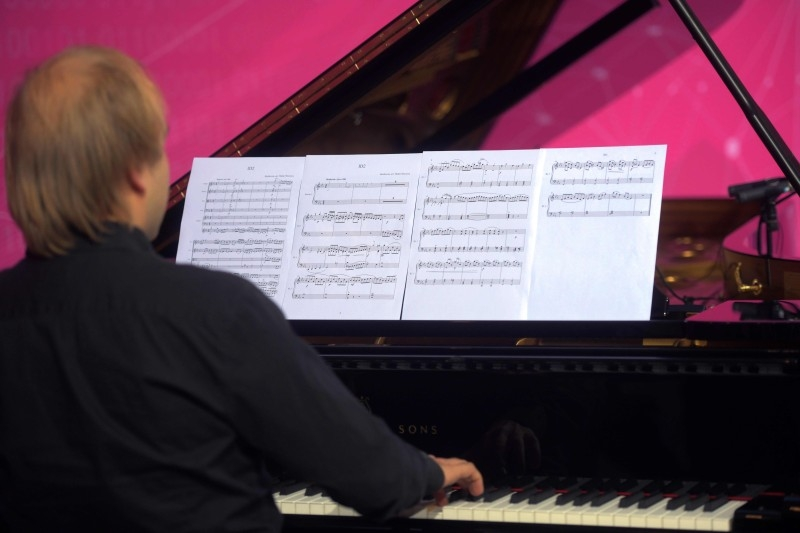 A piano player performs a part of the completion of Beethoven's 10th symphony made using artificial intelligence at the Telekom headquarters in Bonn, western Germany, on Friday. Telekom supports an experiment to complete the composer's 10th symphony using artificial intelligence and a team of international experts from science and music. A string quartet and a pianist perform two minutes of the AI composition live. — AFP