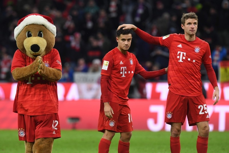 Bayern Munich's German forward Thomas Mueller (R) reacts with Bayern Munich's Brazilian midfielder Philippe Coutinho after the German first division Bundesliga football match against Werder Bremen in Munich on Saturday. — AFP