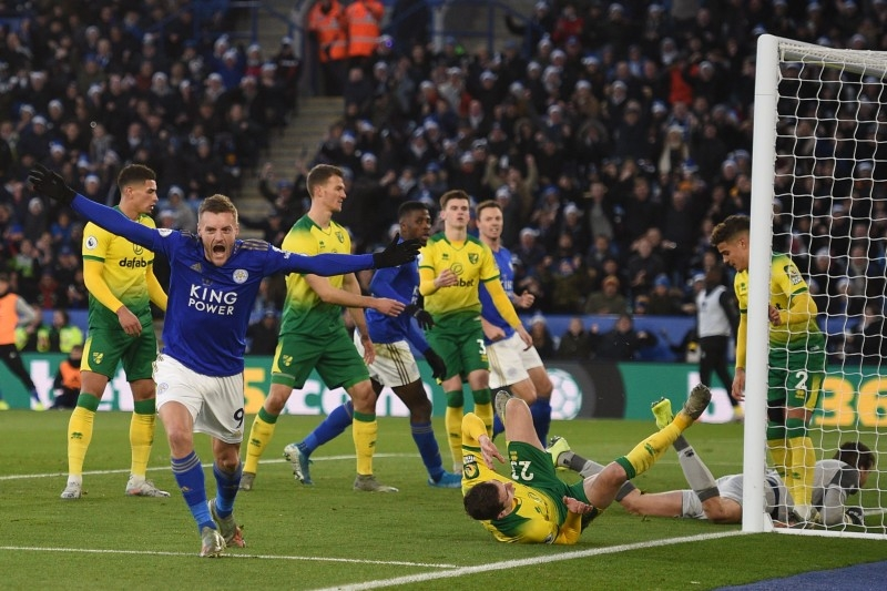 Leicester City's English striker Jamie Vardy (2nd L) turns to celebrate after scoring their first goal during the English Premier League football match against Norwich City at King Power Stadium in Leicester, central England on Saturday. — AFP