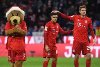 Bayern Munich's German forward Thomas Mueller (R) reacts with Bayern Munich's Brazilian midfielder Philippe Coutinho after the German first division Bundesliga football match against Werder Bremen in Munich on Saturday. — AFP