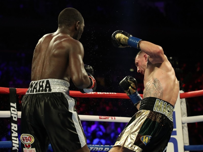 Terence Crawford knocks down Egidijus Kavaliauskas during their bout for Crawford's WBO welterweight title at Madison Square Garden on Saturday in New York City. — AFP