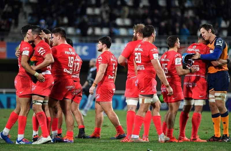 Toulouse's players celebrate after winning the European Rugby Champions Cup rugby union match between Montpellier and Toulouse on Saturday, at the GGL stadium in Montpellier, southern France.  — AFP