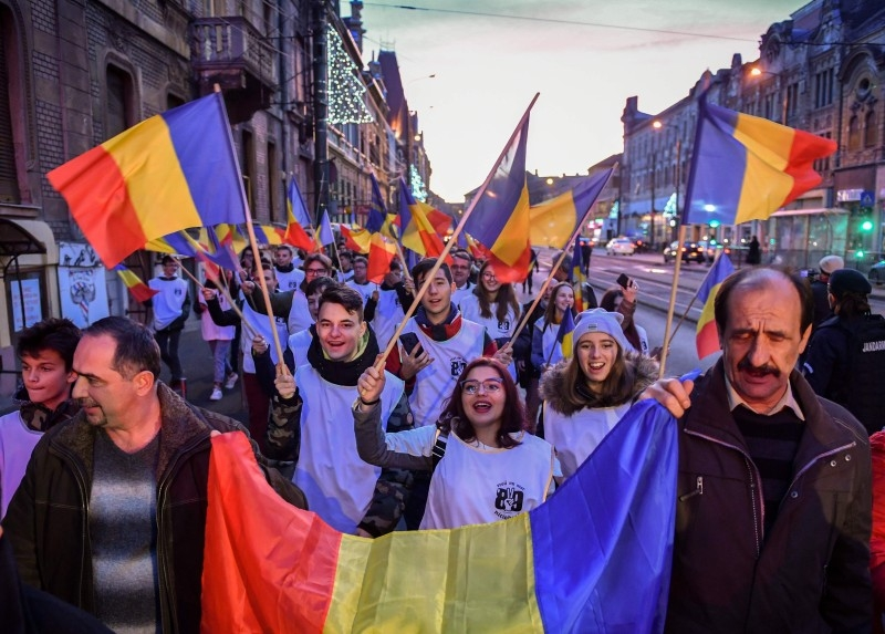 People march on the streets of Timisoara during a commemoration on the occasion of the 30 years of the Romanian Revolution's first victims in Timisoara, Romania on Sunday. -AFP