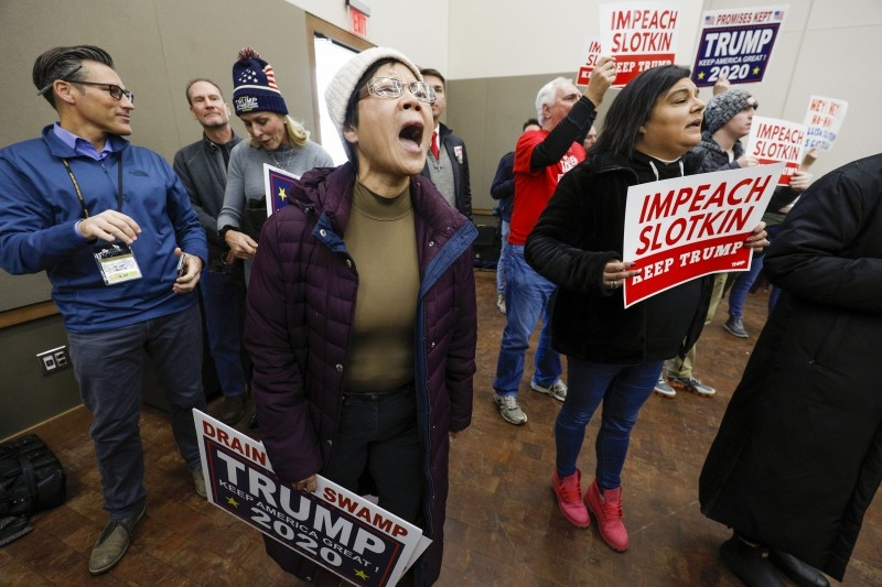 A protester shouts at US Congresswoman Elissa Slotkin at a Town Hall meeting where she was discussing her decision to vote in favor of the impeachment of President Donald Trump to her constituents in Rochester, Michigan, on Monday. — AFP