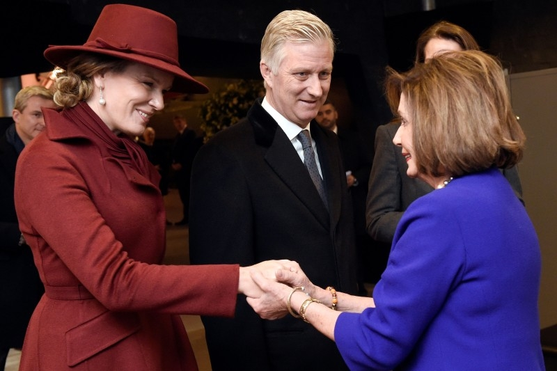 Queen Mathilde and King Philippe of Belgium greet Speaker of the United States House of Representatives Nancy Pelosi before the commemorations of the 75th anniversary of the Battle of the Bulge, in Bastogne, Belgium, on Monday. — AFP