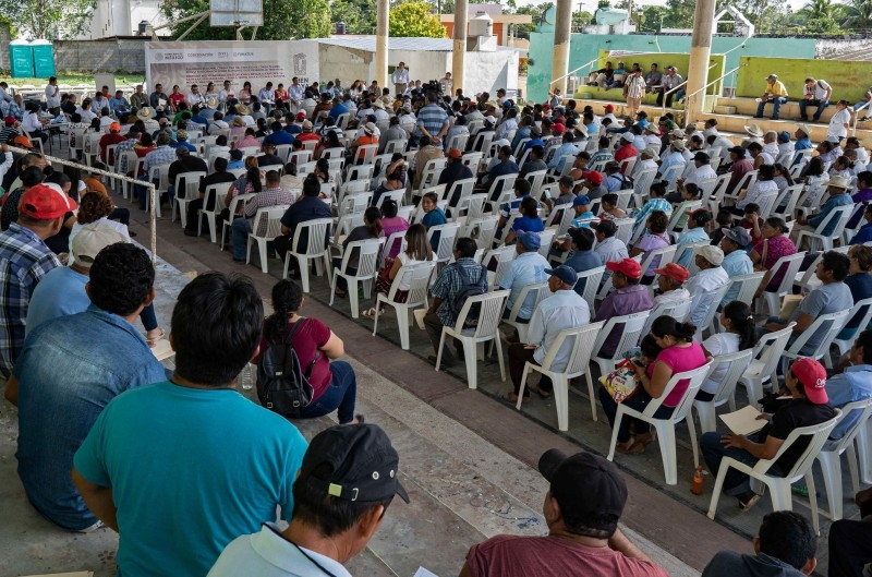 Citizens attend a consultation meeting during a referendum on building a