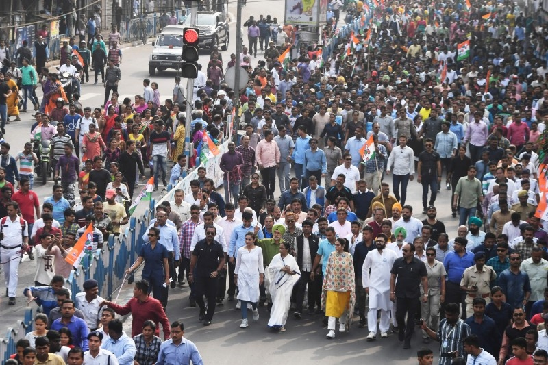 Chief minister of West Bengal state and leader of the Trinamool Congress (TMC) Mamata Banerjee (front C dressed in white) along with party supporters walks in a mass rally to protest against the Indian government's Citizenship Amendment Act (CAA) in Kolkata on Tuesday. -AFP