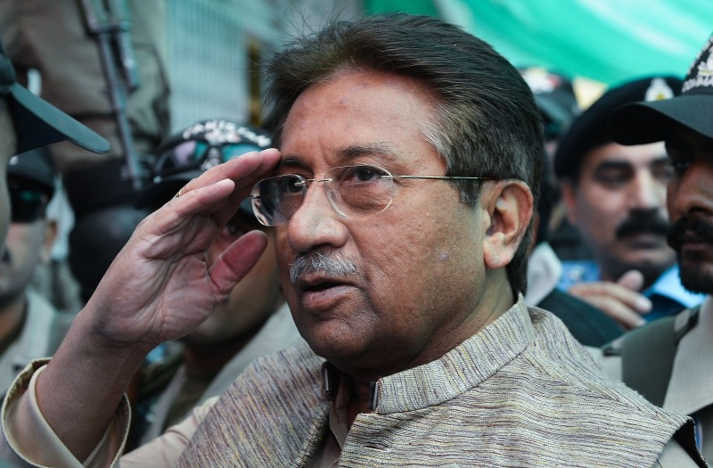 In this file photo taken on April 20, 2013 former Pakistani president Pervez Musharraf (C) is escorted by soldiers as he salutes on his arrival at an anti-terrorism court in Islamabad. -AFP