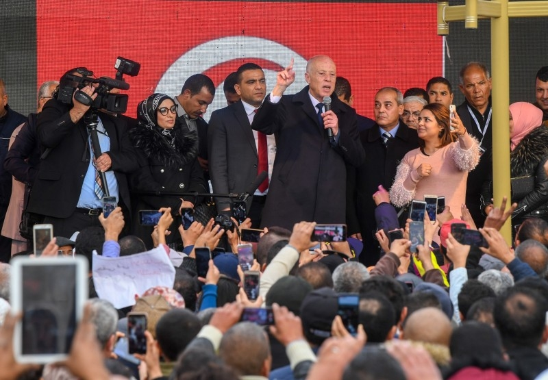 A handout picture provided by the Tunisian Presidency Press Service on Tuesday shows President Kais Saied speaking to a crowd of people in the central Tunisian town of Sidi Bouzid.  -AFP
