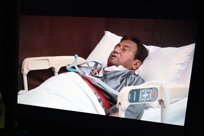 A video statement of the ailing exiled former Pakistani military ruler Pervez Musharraf in a hospital bed in Dubai is pictured on a screen in Islamabad on Thursday. — AFP