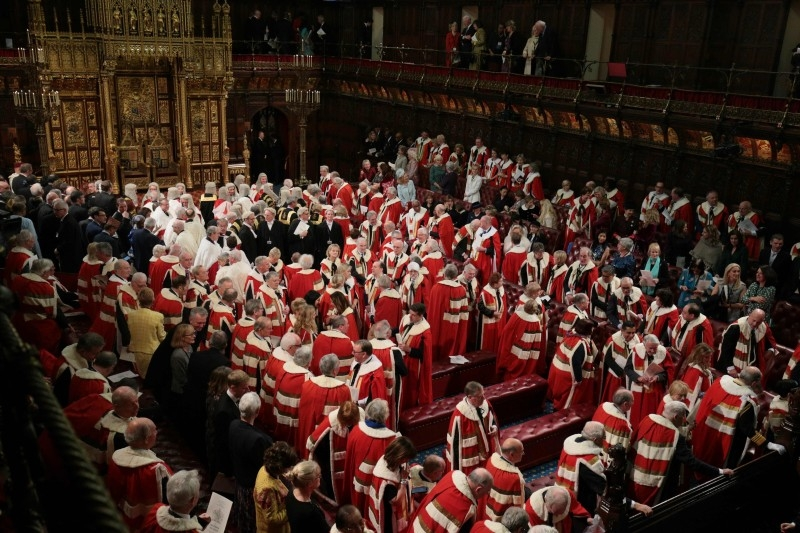 Members of the House of Lords and their guests wait ahead of the Queen's Speech in the House of Lords chamber, during the State Opening of Parliament in the Houses of Parliament in London, on Thursday. — AFP