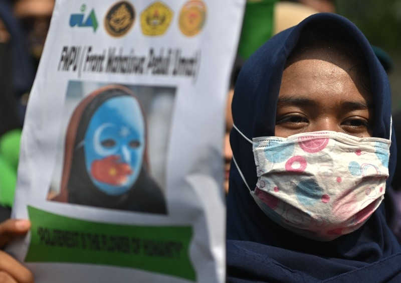 An Indonesian protester displays a poster during a rally to show support for the Uighur minority in China, outside the Chinese embassy in Jakarta, on Friday. — AFP