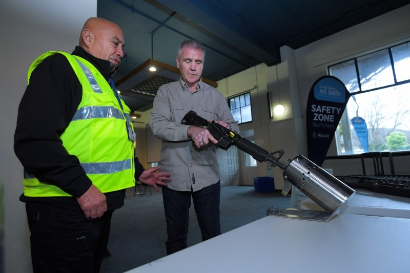 New Zealand police officers handle a firearm example at a press preview ahead of a gun buyback scheme at the Trentham racecourse in Upper Hutt near Wellington in this July 4, 2019 file photo. — AFP