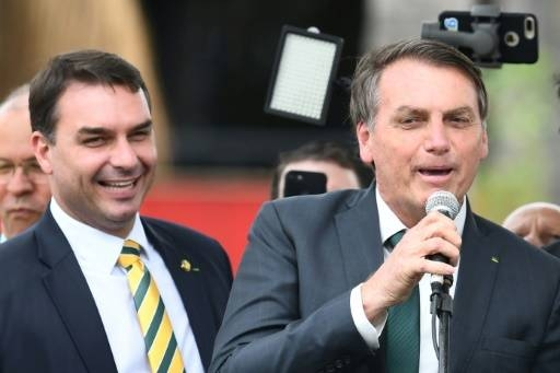 Brazilian President Jair Bolsonaro (R) and his son, Senator Flavio Bolsonaro, are pictured in November 2019. -AFP