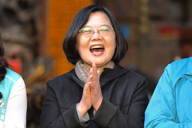 This picture taken on December 3, 2019 shows Taiwan's President and 2020 presidential candidate Tsai Ing-wen clapping during an election campaign event at the Jienan Taoist temple in Pingzhang district in Taoyuan. -AFP