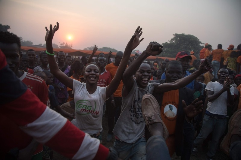 Former Centrafrica's President François Bozize (L) and National Convergence Kwa Na Kwa (KNK) party general secretary Bertin Bea (C) greet the crowd in the Boeing district of Bangui, on Saturday. AFP
