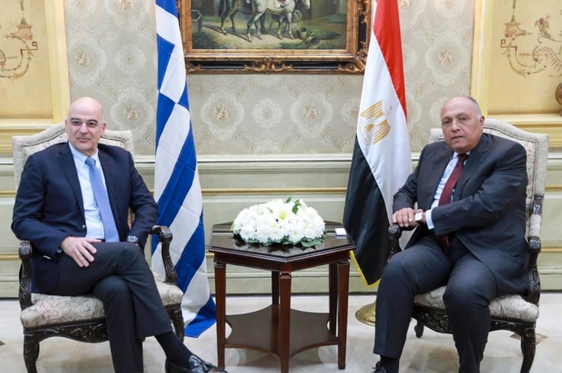 Egyptian Foreign Minister Sameh Shoukry, right, meets with his Greek counterpart Nikos Dendias in the capital Cairo on Sunday. — AFP
