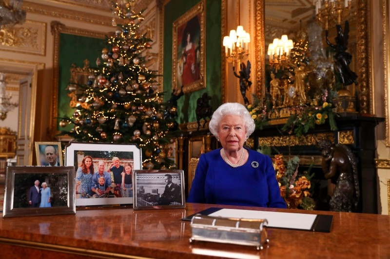A picture released on Tuesday shows Britain's Queen Elizabeth II posing for a photograph after she recorded her annual Christmas Day message, in Windsor Castle, west of London. -AFP