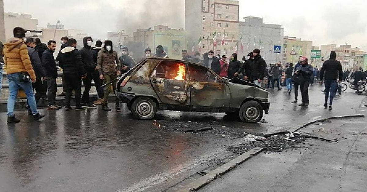 Iranian protesters gather around a burning car during a demonstration against an increase in gasoline prices in the capital Tehran in this Nov. 16, 2019 file photo. — AFP