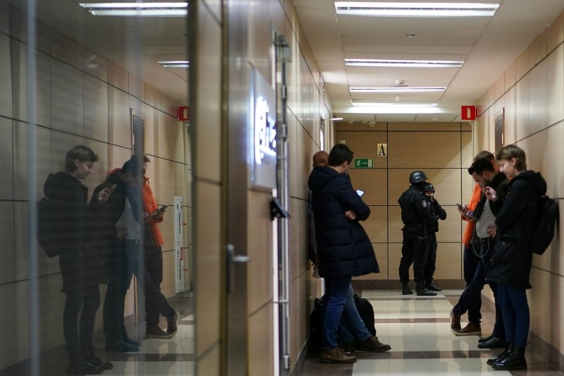 Russian law enforcement agents stand guard at a hallway of a business centre, which houses the office of opposition leader Alexei Navalny's Anti-Corruption Foundation (FBK), in Moscow on Thursday. — AFP