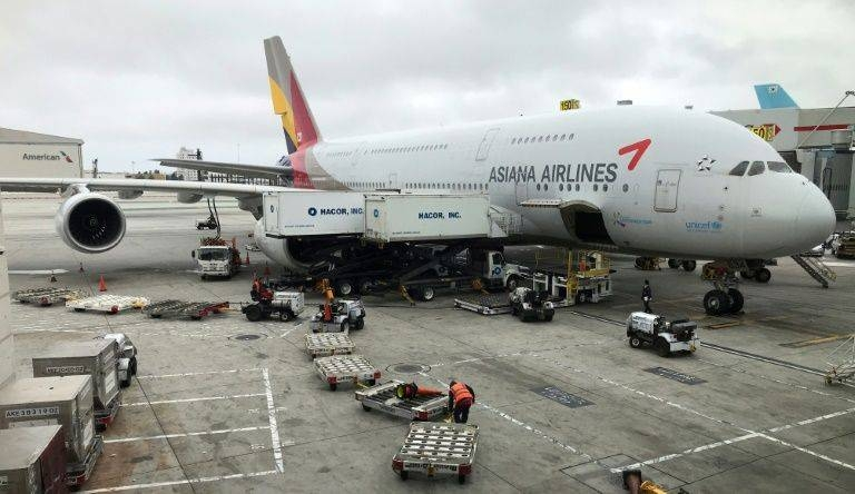 South Korean construction firm on Friday signed a deal to acquire Asiana, the country's second-largest airline, which has long been plagued by financial problems. — AFP