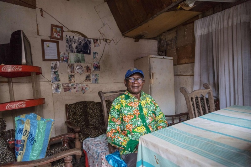 Odile Mbouma, who can recall the horror once French soldiers marched into the town on December 30, 1956, when she was seven, poses for a portrait  in Ekite, on December 11, 2019. -AFP