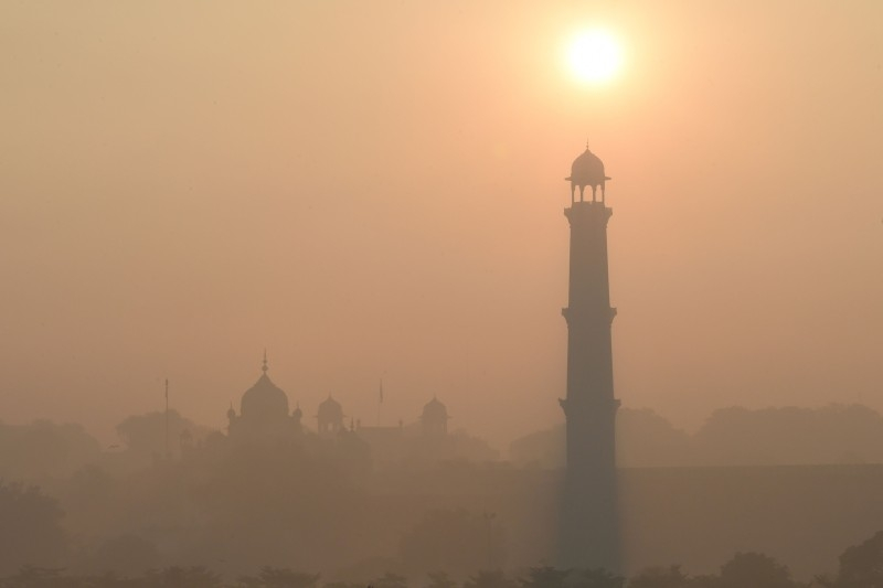 This picture taken on December 6, 2019 shows heavy smog conditions around Badshahi Mosque in Lahore. -AFP